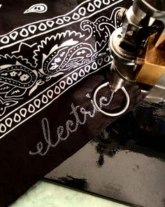 Practicing chain stitching type -- our chain stitching machine is from 1920 -- it is operated freehand by turning a crank handle so you can literally write stitched lines