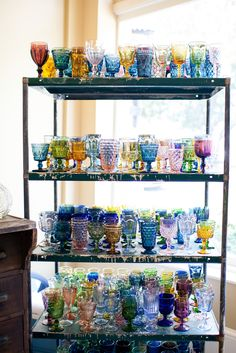 Southern Vintage rental colored stemware and industrial shelves rental