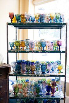 Southern Vintage rental colored stemware and industrial shelves rental