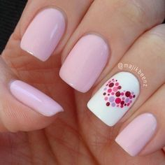 Polka dot heart and pink nails.
