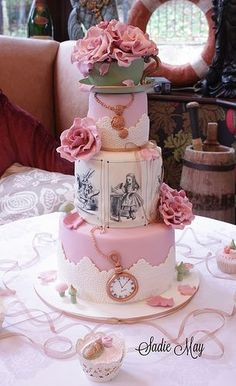 Alice in Wonderland Wedding Cake  www.tablescapesbydesign.com https://www.facebook.com/pages/Tablescapes-By-Design/129811416695  This is so feminine! Could do similar but with sketches like May Gibbs' and have gum leaves in place of the watches and native flowers instead of roses. Top layer for the babies (super healthy), second for the kids (not too unhealthy) and bottom layer for anyone who doesn't mind dairy and eggs.