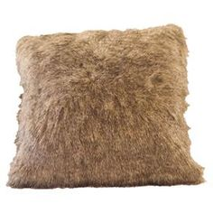 """Throw pillow cover with a faux fur front and chocolate brown faux suede back.    Product: Pillow cover    Construction Material: Acrylic and polyester  Color: Tan   Features: Faux raccoon tail fur frontChocolate faux suede back     Dimensions: 16"""" x 16""""    Note: Insert not included  Cleaning and Care: Dry cleaning recommended"""