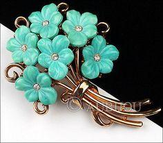 Description: Vintage signed Trifari floral motif brooch, gold tone metal, blue molded glass flowers, clear rhinestones. Designer/Makers Marks, Hallmarks, Tags: Crown Trifari. Age: Circa 1950's. Dimens