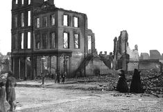 Residents walk through the ruins of Richmond, Virginia, in April of 1865. Richmond served as the capital of the Confederate States of America during the majority of the Civil War. After a long siege in 1865, with General Ulysses S. Grant's Union troops about to take the city, Confederate troops were ordered to evacuate, destroying bridges and burning supplies they they could not carry. A massive fire swept through Richmond, destroying large parts of the city.