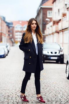 navy coat / distressed black skinnies / white button-down / burgundy sneaks