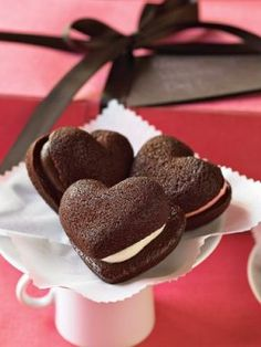 Pure edible nostalgia, our heart-shaped treats recall the whoopie pies beloved by kids but with a decidedly sophisticated twist. The sweet valentines come to us from a bakery in Maine that uses local butter and free-range eggs to make individual ric Whoopie Pie Filling, Whoopie Pies, Yummy Treats, Sweet Treats, Yummy Food, Chocolate Hearts, Chocolate Cake, Heart Cookies, Cake Cookies