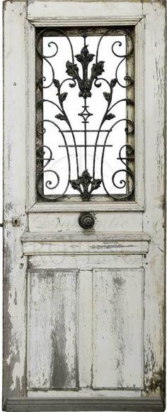 Salvaged Door With Iron Window Grate