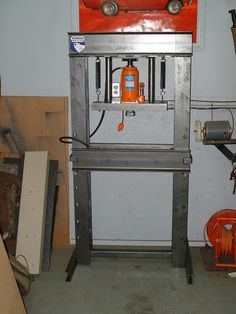Shop Press by Fyrme -- Homemade shop press constructed from channel steel and springs. Powered by a bottle jack. http://www.homemadetools.net/homemade-shop-press-18