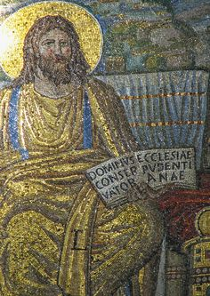 """This mosaic, c.390 is the oldest surviving mosaic in a church, in the basilica of S. Pudenziana in Rome. It shows the Lord Jesus Christ as Protector and Preserver of the universal Church. In his left hand he holds an open book bearing an inscription: """"The Lord [is] the Protector (Maintainer) of the Church of Pudenziana""""."""