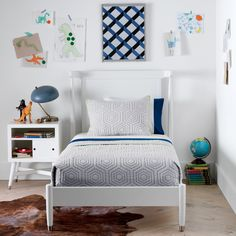 Anatomy of a Room: 5 Essentials for Every Kids' Bedroom. Mid-Century French White Twin Bed | Our Mid-Century Bed exemplifies less-is-more. The paneled headboard and airy cut-outs illuminate the gracefully curved back and tapered dowels. Available in twin or full, this bed easily translates from the kids room to the guest room.