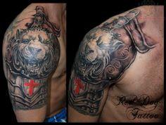 lion crest armor tattoo on shoulder