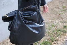 Lupo outdid themselves with this asymmetrical bag. Beautiful leather and multiple pockets for storage combine to create a purse that is truly unique