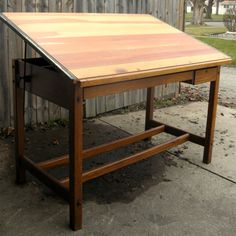 Beautiful solid wood vintage drafting table.  Lovely workmanship, Great history.