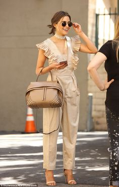 Stylish: Olivia Culpo wore a beige jumpsuit with pleated chest and sleeves while out in Lo...
