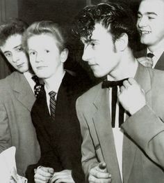 Here is a picture of some Teddy boys. The guys were inspired by the the Edwardian Period but they were seen more in England. Many wore Draped jackets and Zoot suits.