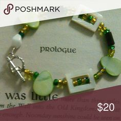 """Leafy Green Toggle Bracelet Green, white and black beads with a silver toggle clasp. 7"""" diameter including clasp. Hand made . New without tags. Jewelry Bracelets"""