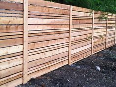 Cedar fence with horizontal boards  for fence along driveway, only half as tall