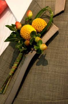 boutenniere - maybe with green hypericum and a green or white pom?