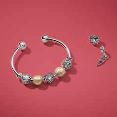 Create a stylish look by combining touches of gold and sterling silver pieces with PANDORA's hand-finished charms and bracelets.