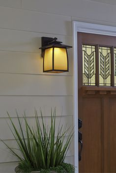 With a transitional design complementing a wide array of architecture, the mission style Wright House Outdoor Wall Sconce by Feiss includes seven outdoor fixtures in an Oil Rubbed Bronze finish with White Opal glass, as well as in a Sorrel Brown finish with Striated Ivory glass. Constructed of aluminum to withstand the elements.