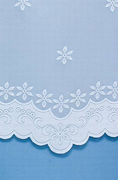 Pettywell is a simple, floral net curtain with a light and airy design.