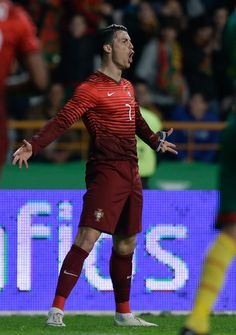 Portugal's Cristiano Ronaldo celebrates after scoring the opening goal during their friendly soccer match with Cameroon Wednesday, March 5 2014, in Leiria, Portugal. The game is part of both teams' preparation for the World Cup in Brazil. (AP Photo/Armando Franca)