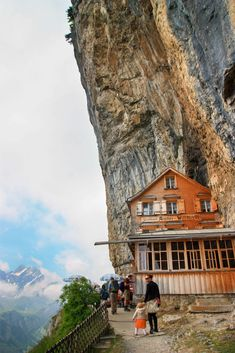 Ebenalp in eastern Switzerland is home to this iconic mountain restaurant, Berggasthaus Aescher, built into the side of the cliff. It's easy to visit with a cable car ride and short walk. It's famous on Instagram and a great choice for visitors. Optional hike down to the beautiful Seealpsee lake below for even more mountain views. Directions, trail map and tips for this hike on our website. Family Destinations, Amazing Destinations, Mountain Trails, Mountain View, Best Of Switzerland, Alpine Lake, Trail Maps, Swiss Alps, Best Hikes