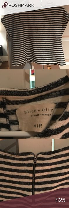 Alice & Olivia crop top Super cute Alice & Olivia crop top. Black and white stripe. Soft cotton. Worn once maybe? Size small. Great for layering and to show your sexy midriff! Alice + Olivia Tops Crop Tops