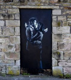 New #Banksy. Mobile phone embrace.