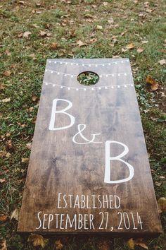 Brittney & Brian on Borrowed & Blue.  Photo Credit: A Muse Photography Custom Wedding Wood Cornhole Boards Rustic Elegant String lights