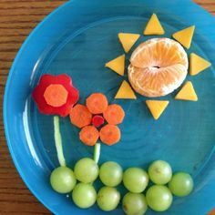A dose of color does a body good.  tangerine and cheese sun red bell pepper and carrot flowers celery stalks grape grass