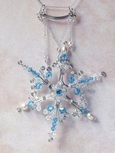 Winter snowflake necklace. Blue topaz and sterling silver.