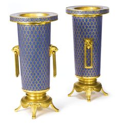 Ferdinand Barbedienne\n1810-1892\nA pair of Neo-Grec gilt bronze and cloisonné enamel vases\nFrance, last quarter 19th century, Each signed F. BARBEDIENNE\nHeight 11 3/4 in.\nHeight 30 cm