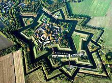 """Fortification - Wikipedia """"Fort Bourtange star fort, restored to 1750 situation, Groningen (province), Netherlands. Star Fort, Tourist Spots, Fortification, Best Western, Palaces, Aerial View, City, World, Kid Playroom"""