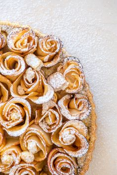 With a little extra effort you can transform your apple tart into this gorgeous Chai-spiced Apple Rose Tart. A buttery shortcrust pastry is filled with a chai-spiced frangipane filling and topped with elegant apple roses! Fun Baking Recipes, Tart Recipes, Best Dessert Recipes, Fun Desserts, Sweet Recipes, Delicious Desserts, Snack Recipes, Fruit Dessert, Apple Rose Tart