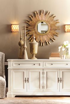 Gorgeous in gold. This wall mirror is a statement-making centerpiece on any wall. Update your home for summer with a sunburst wall mirror. HomeDecorators.com