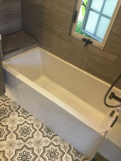 Decorative cement tile floor and porcelain tile walls. Design by Andrea Cambern