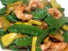 Yellow Squash, Snow Peas, and Shrimp Sir-Fry Recipe - -    The flavors of the shrimp and vegetables are delicate and infused with the flavor from the sauce. This is such a refreshing and healthy delicious meal.   No other accompaniments are required - well maybe some lovely jasmine tea.    http://www.weavethousandflavors.com/2010/04/if--there-is-one-thing-i-know-in-certainty-is-that-one-should-never-take--ones-stir-fry-too-seriously-the-most-successful-st.html