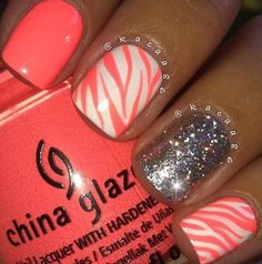 cute coral nails with animal print and glitter accent nails