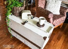 A funky tool box side table with hidden junk storage from Funky Junky Interiors. I love the rusty piece of metal used as a coaster.