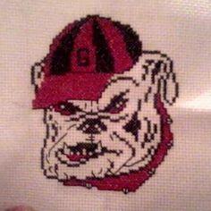 GO UGA! A bulldog I cross stitched, I personalize it with a name or saying above or beneath the picture. :)