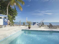 Cozy Oceanfront cottage in Islamorada. Private gated property with wide open ocean views. Includes pool Hottub and dock. One of a kind.