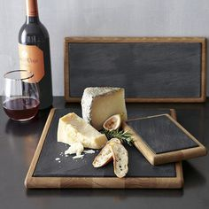 Like idea of chalkboard paint to board   Slate and wood boards perfect for parties and hostess gifts. Use the slate slab on its own or with the wood board as a serving platter for cheese and other appetizers. The board can also be turned over and used as a chopping block. West Elm. $34