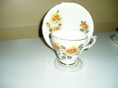 Delphine china tea cup and saucer yelloe floral