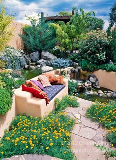 Susan Blevins of Taos, New Mexico, created an elaborate home garden featuring containers, perennial beds, a Japanese themed path and a regio...