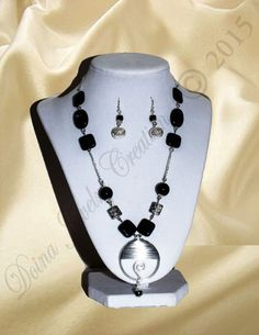 Onyx with silver plated metal beads R via DJC - Handmade jewelry. Click on the image to see more!