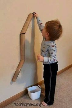 Tape paper towel roll cores to wall to create a ball drop chute for toddlers! Fun fun!