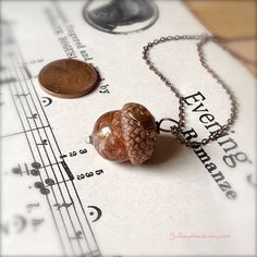 Mini Glass Acorn Necklace - Pale Pink Goldstone Sparkle with Vintage Metal Leaf by Bullseyebeads