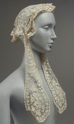 c. 1860 Irish (Carrickmacross), lace cap of linen net, linen insertion and cotton embroidery.