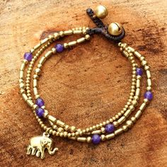NOVICA Brass Bracelet Purple-color Gems Beaded Jewelry ($21) ❤ liked on Polyvore featuring jewelry, bracelets, brass, charm, charm jewelry, brass jewelry, beaded gemstone jewelry, gemstone bangle and gem jewelry